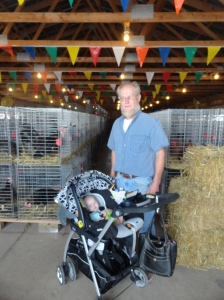 Papa Showing Vivian the Chicken Barn at the Fair
