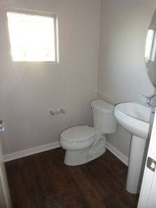 Powder Bathroom Complete with Wood Flooring and Paint