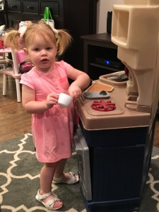 Playing with her New Kitchen