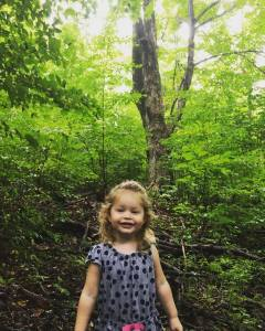 Little Girl in a Big Woods
