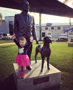 Vivian Next to the Bronze Sculpture of Donald Douglas and His Dog, Bar